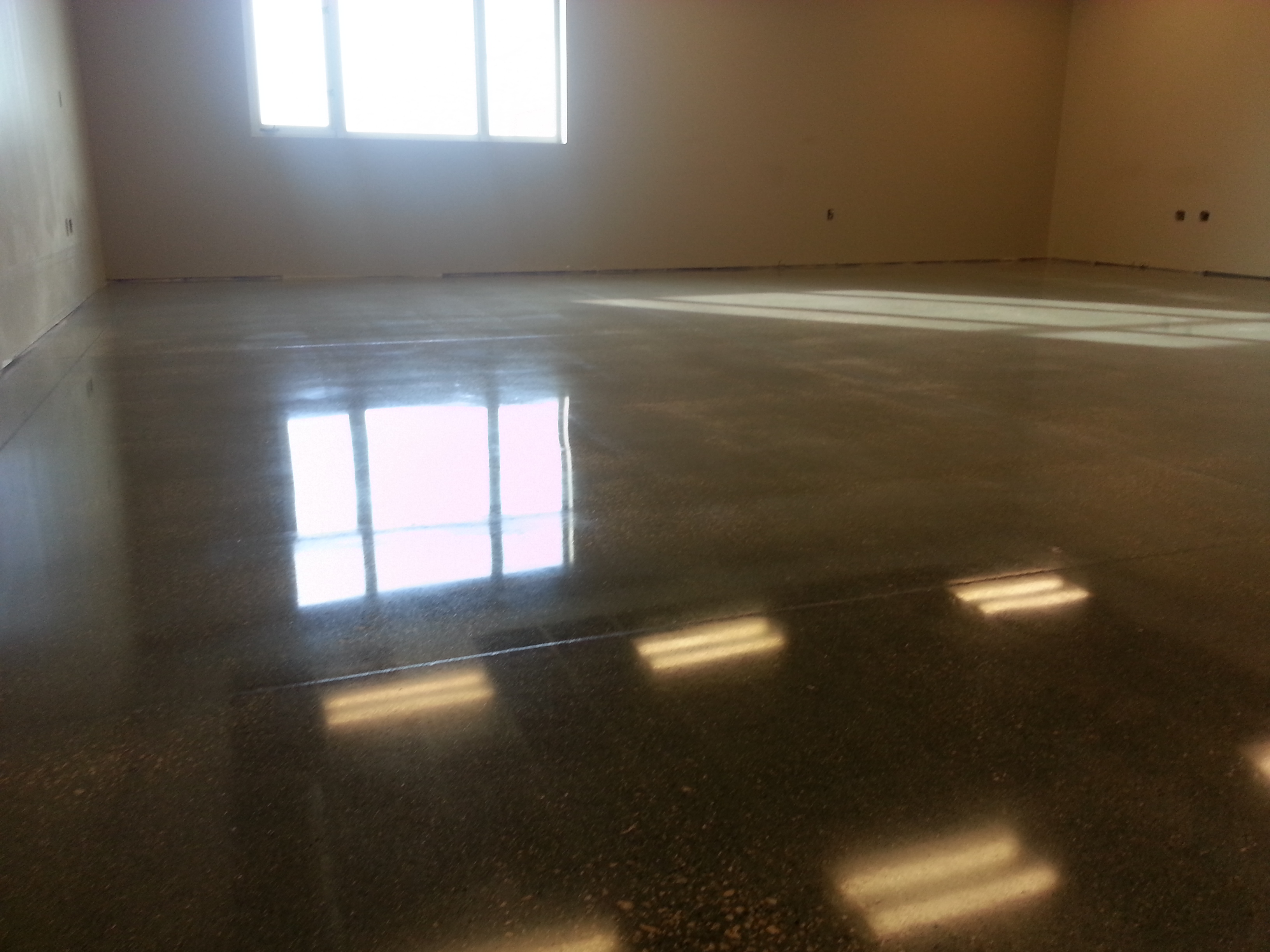 Medium to High Gloss floor sheen at an institutional building.