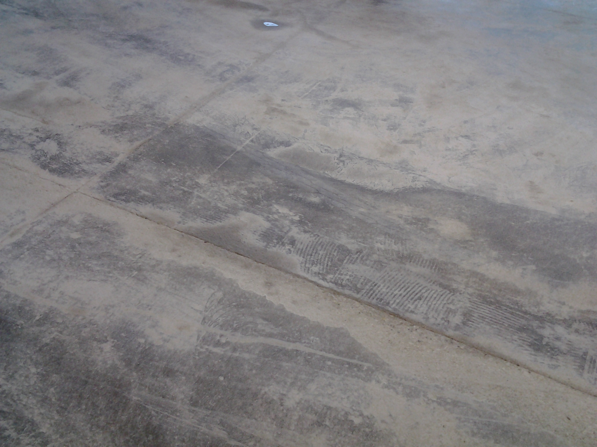 Concrete slab after floor preparation: Tile grout removal