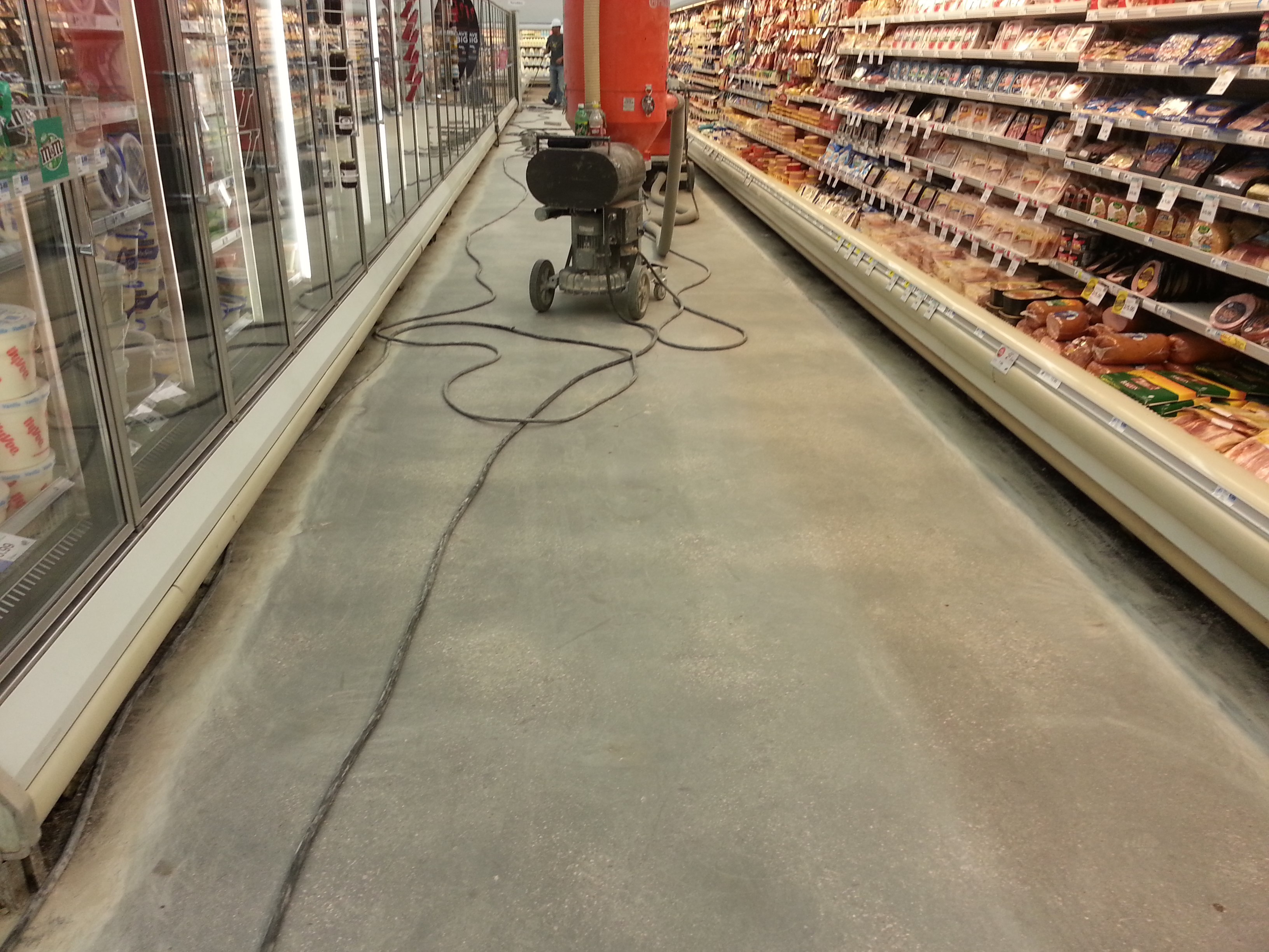 In process VCT (Vinyl Composition Tile) tile removal at grocery store in Iowa City IA with no edge work