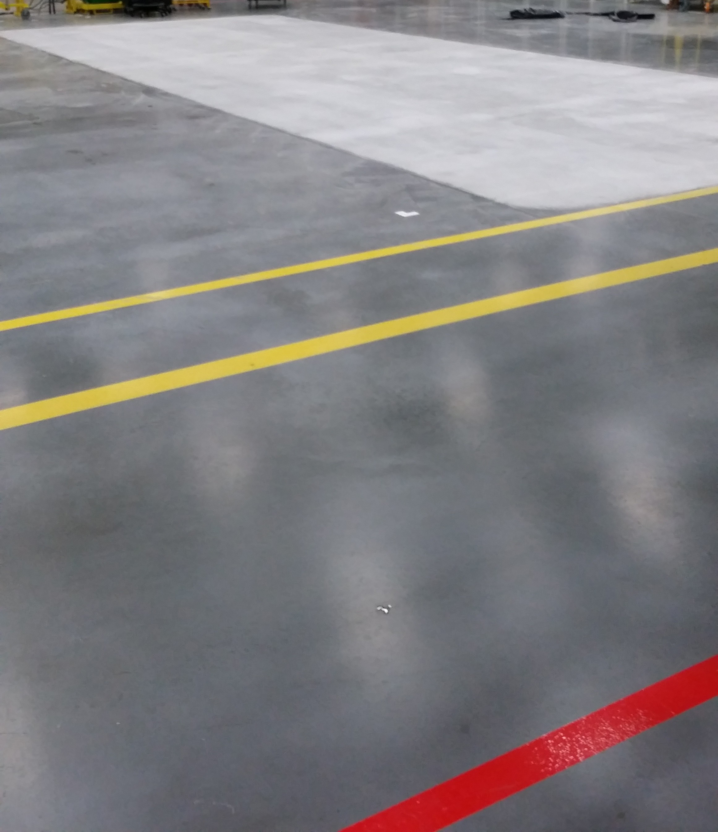 Matte floor finish at manufacturing company in Des Moines, Iowa.