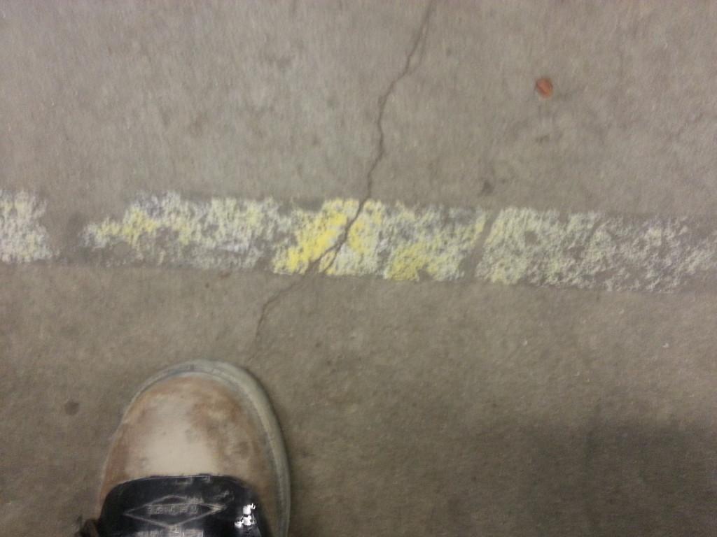 Old faint line striping on epoxy floor