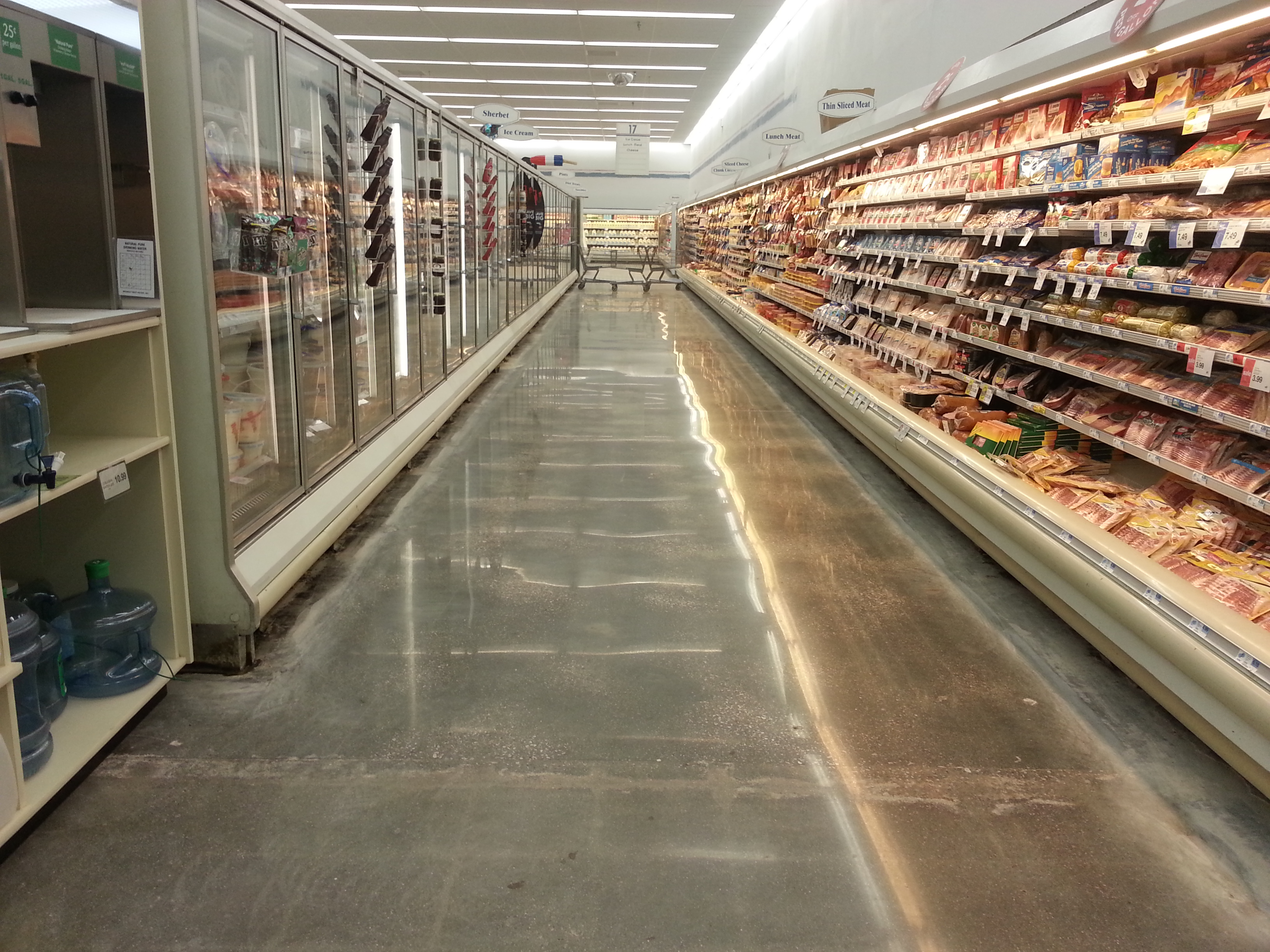 VCT (Vinyl Composition Tile) tile removal on a grocery store floor with no edge work in Iowa City, IA